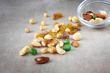 Assorted healthy mixed nuts on wooden textured background Stock Photo - 24756812
