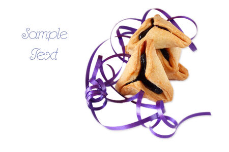 purim: Hamantaschen cookies or hamans ears for Purim celebration  isolated