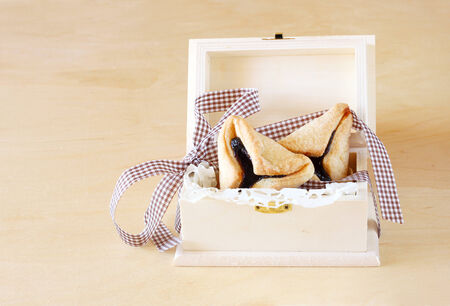 hamantasch: Hamantaschen cookies or hamans ears for Purim celebration in wooden box