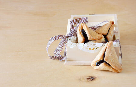 hamantaschen: Hamantaschen cookies or hamans ears for Purim celebration in wooden box