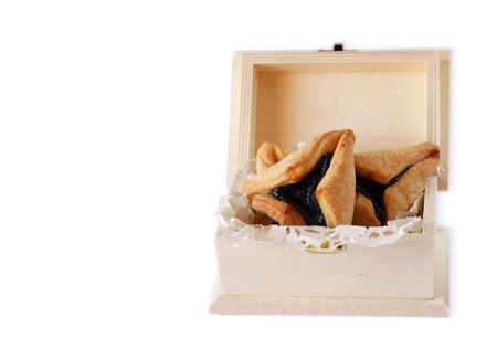 haman: Hamantaschen cookies or hamans ears for Purim celebration in wooden box  isolated