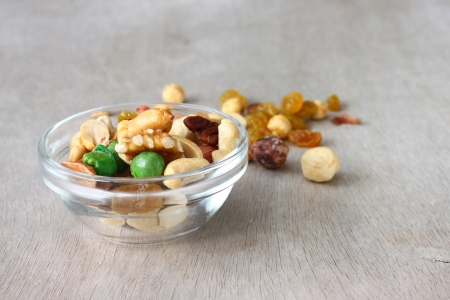 Assorted healthy mixed nuts on wooden textured background Stock Photo - 25095203