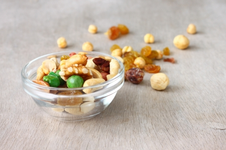 Assorted healthy mixed nuts on wooden textured background Stock Photo - 25095204