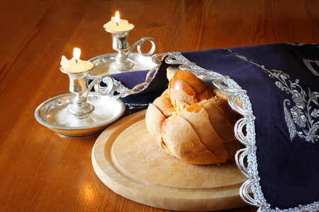 kiddush: Sabbath image  challah bread and candelas on wooden table