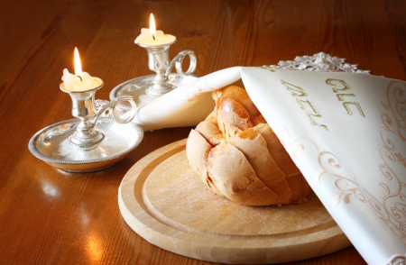 sabbath: Sabbath image  challah bread and candelas on wooden table
