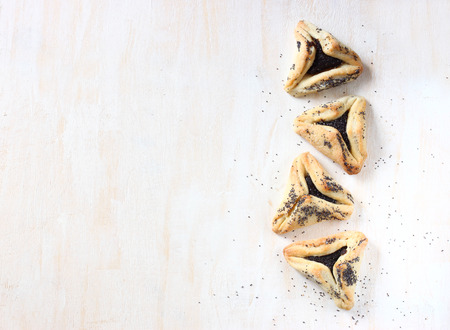 jewish food: Hamantaschen cookies or hamans ears for Purim holiday celebration   top view  Stock Photo