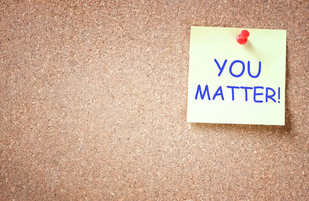 business matter: sticky note pinned to cork board with the phrase you matter    Stock Photo