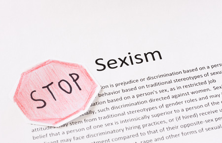 stop sexism phrase  prejudice or discrimination based on a person s gender   photo