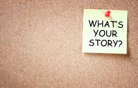 room for text: what is your story concept  sticky pinned to cork board with room for text   Stock Photo