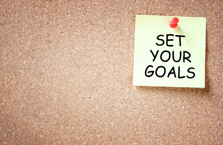 set goals: set your goals concept  sticky pinned to corkboard with room for text    Stock Photo