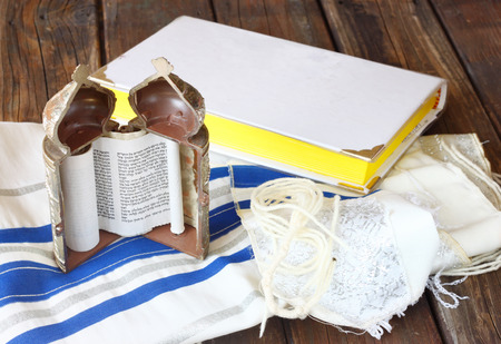 jewish torah and talit on wooden table Stock Photo