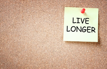 better living: live longer concept  memo note pinned to cork board  room for text  Stock Photo