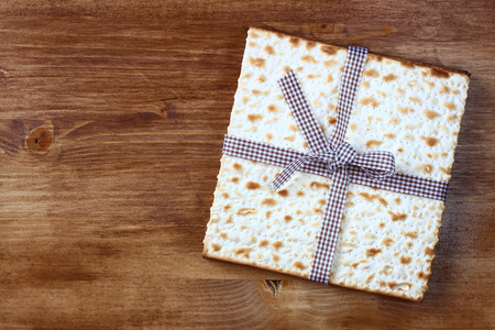 matzoh: passover background  wine and matzoh  jewish passover bread   over wooden background   Stock Photo