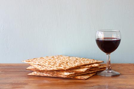 matzoth: passover background  wine and matzoh  jewish passover bread   over wooden background   Stock Photo