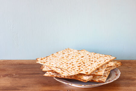 passover background  matzoh  jewish passover bread   over wooden background   photo