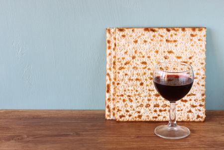 pesakh: passover background  wine and matzoh  jewish passover bread   over wooden background   Stock Photo