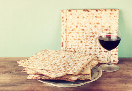 matzo: passover background  wine and matzoh  jewish passover bread   over wooden background   Stock Photo