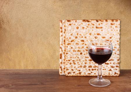 matzos: passover background  wine and matzoh  jewish passover bread   over wooden background   Stock Photo