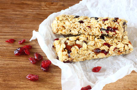 granola bar or energy bar on wooden background photo