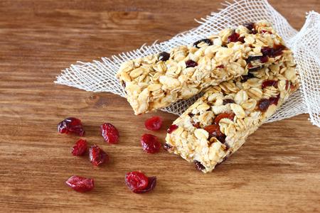 granola bar: granola bar or energy bar on wooden background