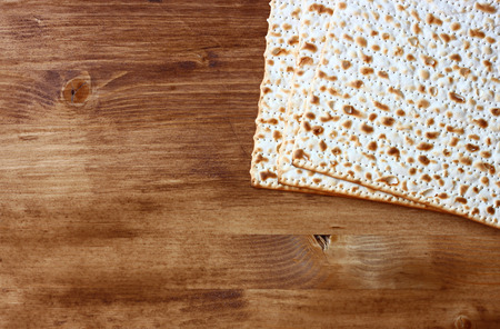 passover background  wine and matzoh  jewish passover bread  over wooden background