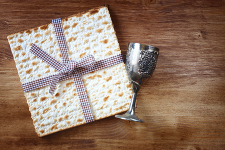 seder: passover background  wine and matzoh  jewish passover bread  over wooden background