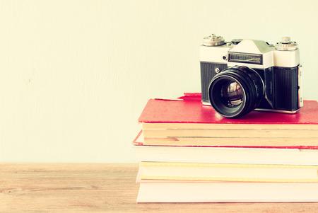 vintage camera on old books  vintage effect photo