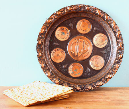 passover background  plate and matzoh  jewish passover bread  over wooden background   photo