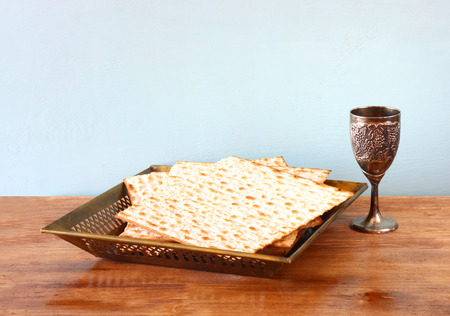 passover background  wine and matzoh  jewish passover bread  over wooden background   Stock Photo