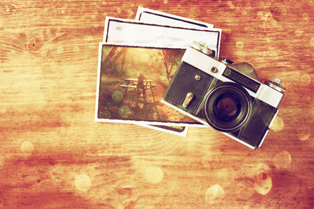 vintage old camera and postcard on wooden background photo
