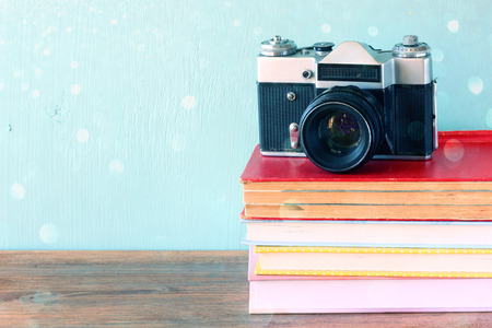 instagram: old camera over stack of books