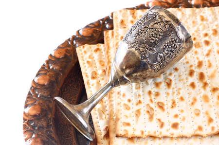 Passover background  wine and matzoh  jewish passover bread   isolated photo