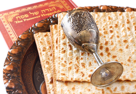 Passover background  wine and matzoh  jewish passover bread   isolated photo