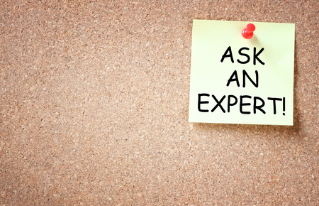 differently: sticky note over cork board with the phrase ask an expert   room for text