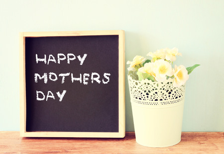 happy mother day written on chalkboard, filtered image    photo