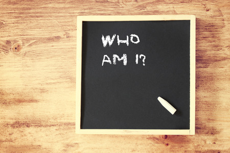 self awareness: who am i concept written over chalkboard