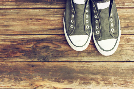 wooden shoes: sneakers on wooden deck