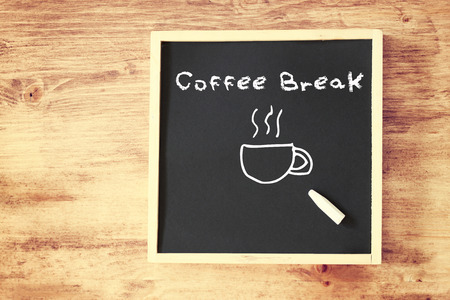 chalk board with the phrase coffee break written on it    photo