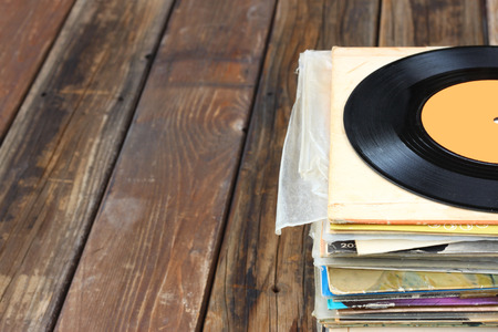 turntables: close up of old record and records stack    Stock Photo