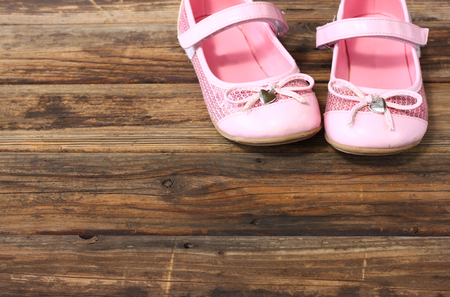 girl shoes over wooden deck floor  photo