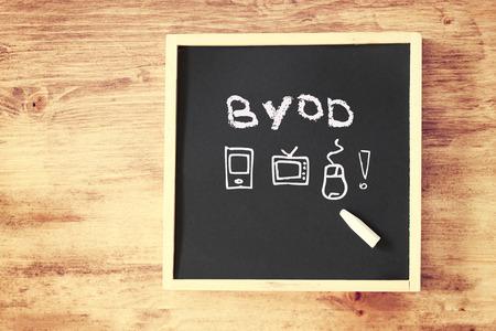 byod concept written on blackboard   photo