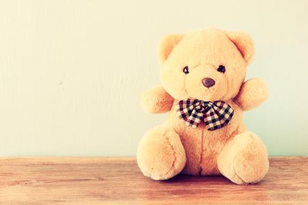 valentine s day teddy bear: teddy bear on wooden table