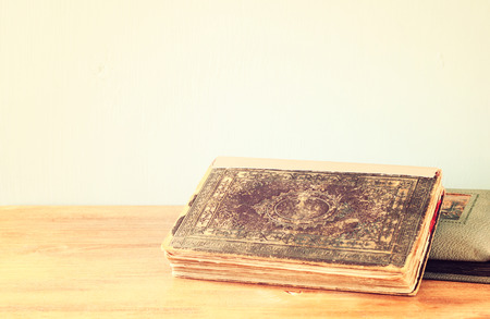 old book on wooden shelf  retro filter    photo