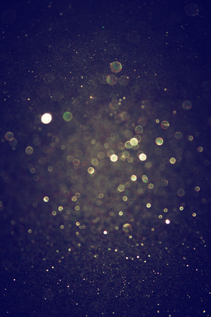 glitter vintage lights background  light gold and black  defocused    免版税图像