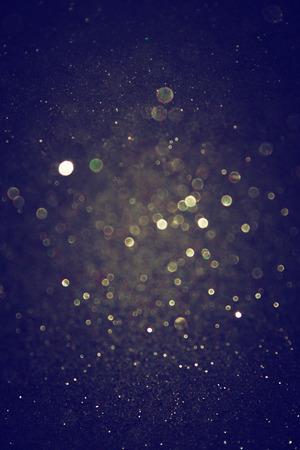 magie: gold glitter feux cru fond clair et noir de flou artistique