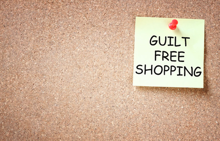 cruelty: guilt free shopping concept  sticky pinned to board and room for text
