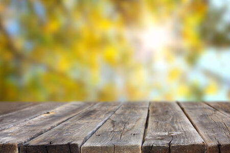 wood planks and out of focus background with sun flare  room for product display    photo