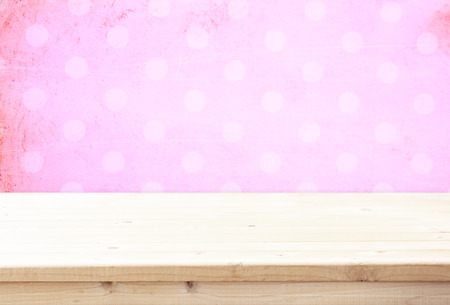 wood board and pink vintage background for product display
