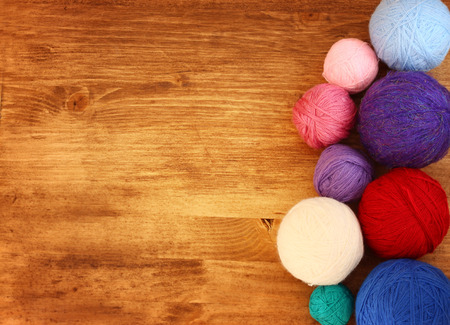 yarn: top view of wool balls over wooden table   Stock Photo