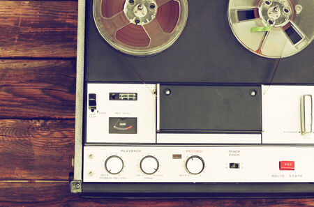 playlist: close up of old reel to reel recording machine  filtered image